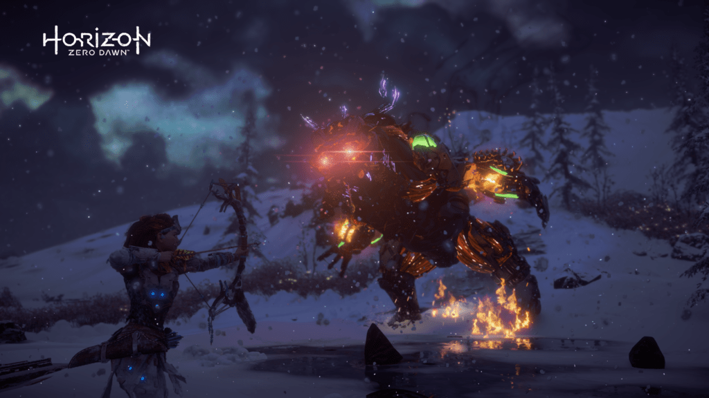 Aloy fighting a giant fire bear machine creature drawing her bow in a snowy area in Horizon Zero Dawn
