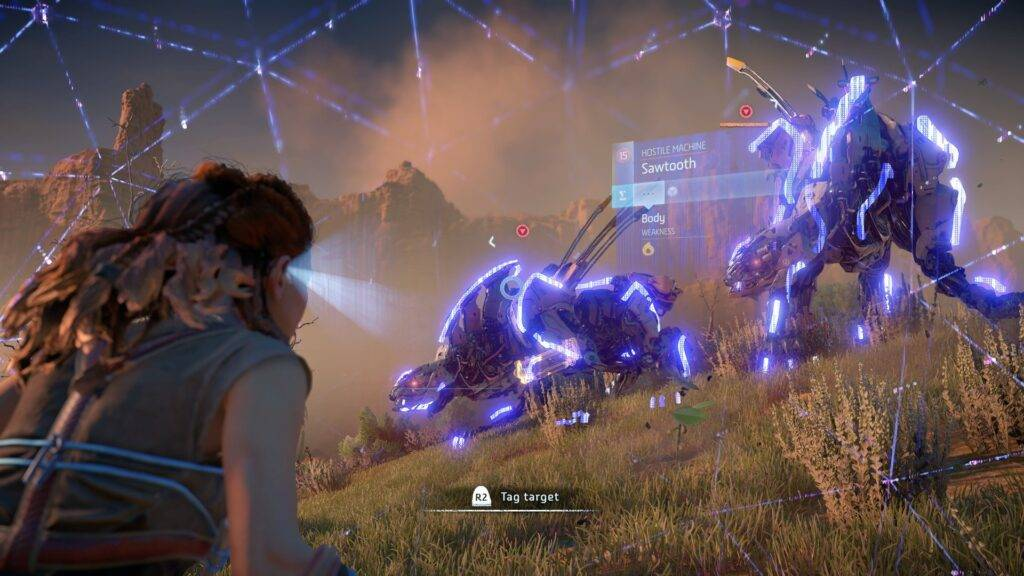 Aloy using her focus to identify weaknesses in the creature machines on a grassland in Horizon Zero Dawn